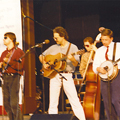 The Johnson Mountain Boys at the Sylvan Theater, Washington, DC,   July 4, 1994. L-R: Eddie Stubbs, David McLaughlin, Dudley Connell, Ira, Tom Adams.